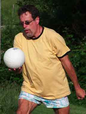 Man Serving Volleyball
