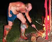Hunter lighting the fire
